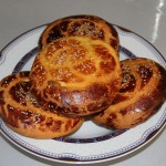 Komaj: A sweet date bread with turmeric and cumin, similar to nan e gisu.